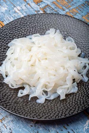 White konjac shirataki noodles, gluten free and no fat diet vegetarian and vegan Asian food close up