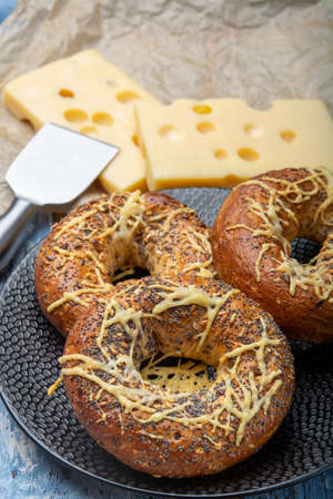 Tasty baked bagels with melted french emmental cheese  close up 写真素材 - 133480511