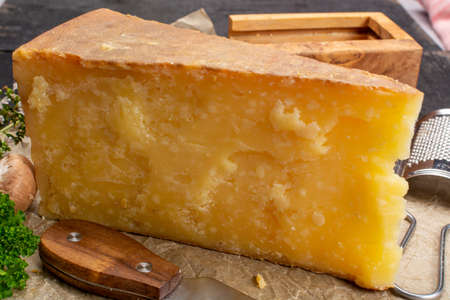Cheese collection, aged yellow hard, Maniva cheese from Alpine valleys near Mount Maniva, North Italy