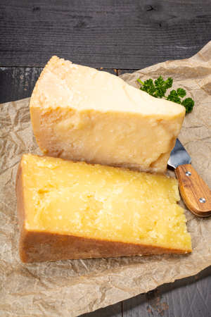 Cheese collection, hard old cheeses from North Italy, aged Maniva cheese from Alps, parmesan from Parma or Grana Padano close up