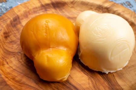 Cheese collection, white and smoked yellow italian scamorza cheese 写真素材