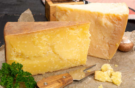 Cheese collection, hard old cheeses from North Italy, aged Maniva cheese from Alps, parmesan from Parma, Grana Padano and grater