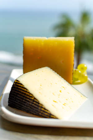Spanish sheep cheese served with white outside with sea view close up 写真素材