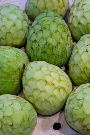 Tropical fruit cherimoya, ice cream fruit or custard apple on market in Spain