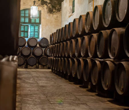 Production of fortified jerez, xeres, sherry wines in old dark oak barrels in sherry triangle, Jerez la Frontera, El Puerto Santa Maria and Sanlucar Barrameda Andalusia, Spain
