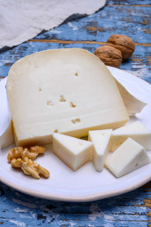 Cheese collection, Dutch hard white goat cheese close up Stockfoto