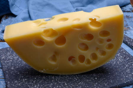 Cheese collection, french hard cheese with holes emmentaler close up