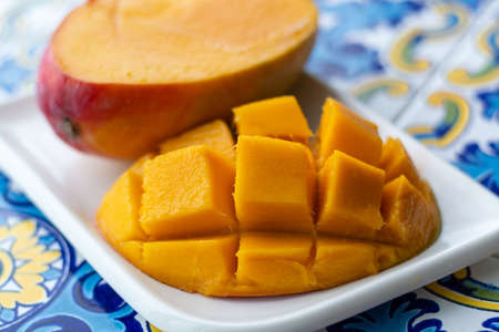 Fresh ripe mango fruit, new harvest on plantations of mango trees in Tropical Coast near Malaga, Andalusia, Spain