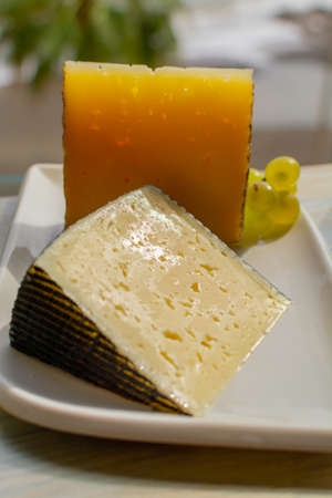 Spanish sheep cheese served with white outside with sea view close up Stockfoto
