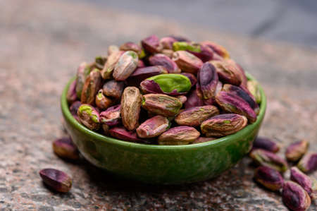 High quality green pistachio nuts growing on slopes of Mount Etna in Bronte, Sicily, Italy, close up Stock Photo