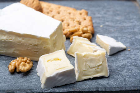 Cheese collection, piece of French brie cheese with white mold close up Stock fotó - 136382547