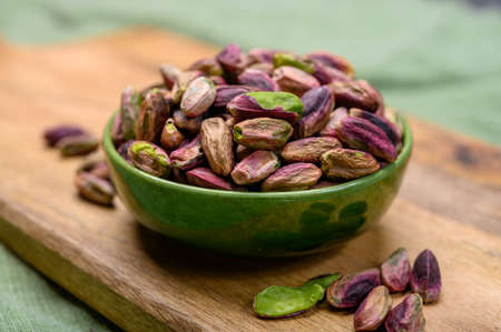 High quality green pistachio nuts growing on slopes of Mount Etna in Bronte, Sicily, Italy, close up