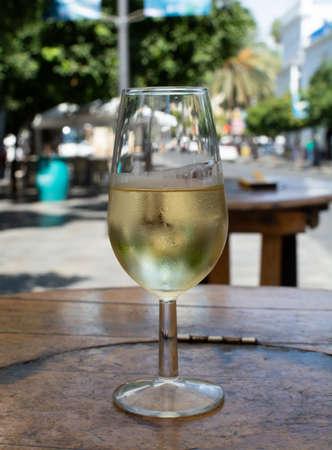 Sherry wine tasting, dry fino, manzanilla or palomino jerez fortified wine in glasses, Jerez de la Frontera, Andalusia, Spain close up