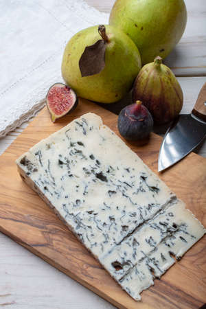 Gorgonzola picant Italian blue cheese, made from unskimmed cow's milk in North of Italy served with fresh figs and pears