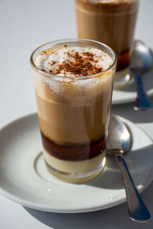 Special coffee of Canarian islands in Spain, sweet barraquito coffee with layers and alcohol served in glass