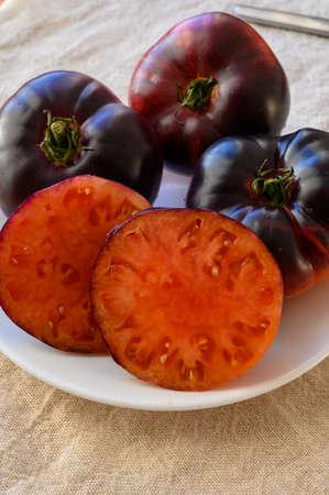 Ripe organic tomato Purple Calabash close up