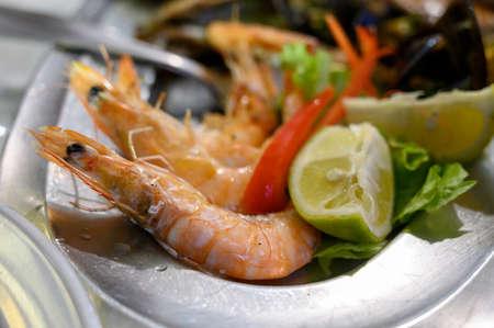 Fresh cooked langoustines shrimps served with lemon