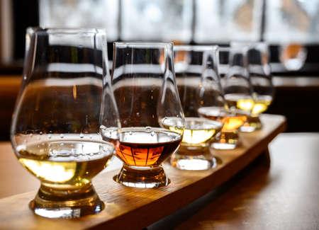 Flight of Scottish whisky, tasting glasses with variety of single malts or blended whiskey spirits on distillery tour in Scotland, UK Reklamní fotografie