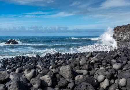 Dangerious ocean stormy waves hits black lava rocks on Playa de la Bombilla, La Palma island, Canary, Spain, bad winter weather conditions