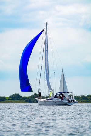 Weekend sailing on small jacht boat on riviers and canals in Kaag, South Holland, Netherlands