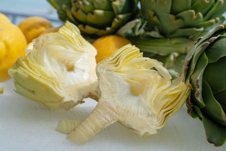 Cooking dinner with fresh green artichokes heads, tasty vegetarian food