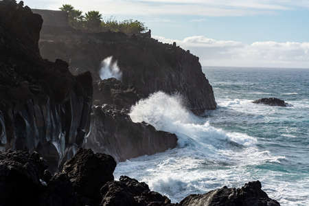 Dangerious ocean stormy waves hits black lava rocks on La Palma island, Canary, Spain, bad winter weather conditions