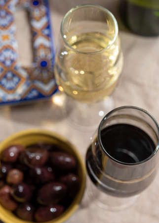 Close up tasty  fortified wine from Andalusia, Spain, different types of sherry in glasses and olives, colors of Andalusisa Stock Photo