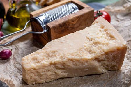 One piece of authentic Parmigiano-Reggiano or Parmesan Italian hard, granular cheese close up Reklamní fotografie