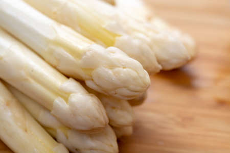 Fresh raw organic high quality white asparagus vegetable ready to cook close up