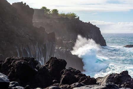 Dangerious ocean stormy waves hits black lava rocks on La Palma island, Canary, Spain, bad winter weather conditions Foto de archivo