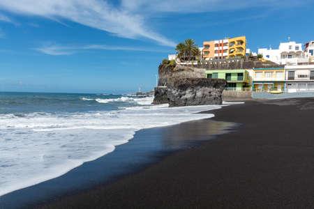 Black lava sand beach in Puerto Naos, La Palma, Canarian islands, Spain in winter