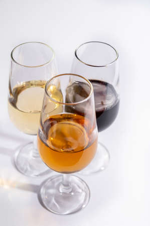 Fortified wine from Andalusia, Spain, different types of dry and sweet  sherry in glasses on white background close up