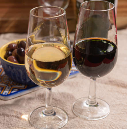 Close up tasty  fortified wine from Andalusia, Spain, different types of sherry in glasses and olives, colors of Andalusisa Reklamní fotografie