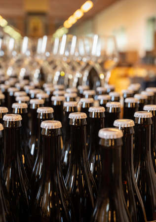 Many Belgian beer bottles in abbey shop close up