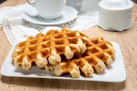 Tasty Belgian dessert, homemade Brussels sugar waffles close up