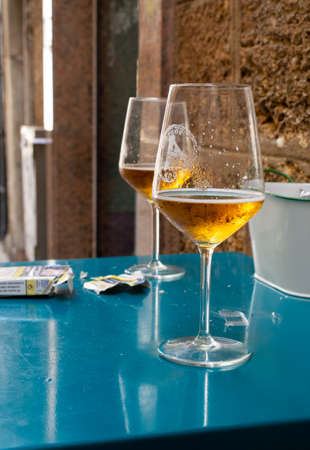 September 2, 2019, El Puerto de Santa Maria, Andalusia, Spain, sherry wine from bodega in glasses and pack cigarettes on small outdoor table in cafe Redakční