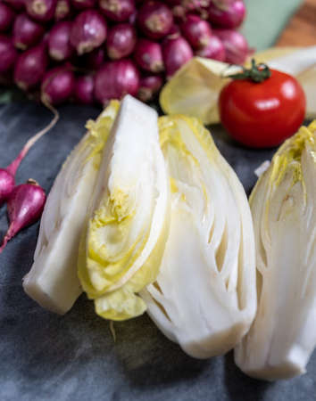 Fresh Belgian endive or chicory bitter salad ready to cook or eat close up Banque d'images