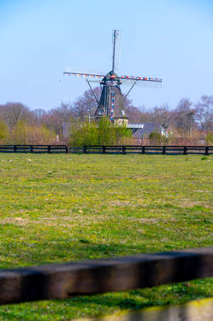 Traditional old Dutch wind mill in North Brabant in sunny day 版權商用圖片