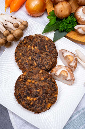 Tasty organic vegetarian food, burgers with champignons mushrooms, buna shimeji, carrot and onion