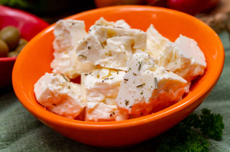 Ingredient for traditional Greek salad, fresh white salted feta cheese with herbs Banque d'images