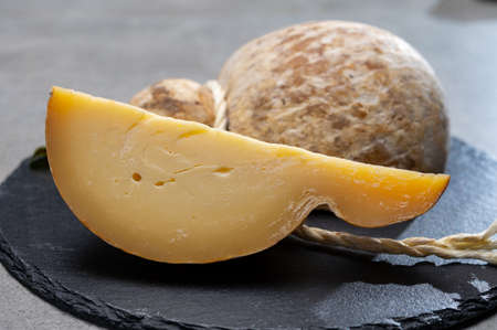 Italian semi hard matured caciocavallo cheese, handmade and aged in natural underground caves in Apulia region close up