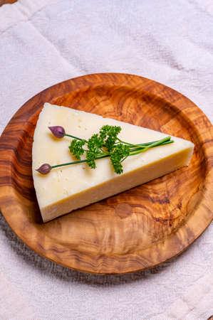 Pieces of matured pecorino romano italian cheese made from sheep milk in Lazio, Sardinia or Tuscany close up