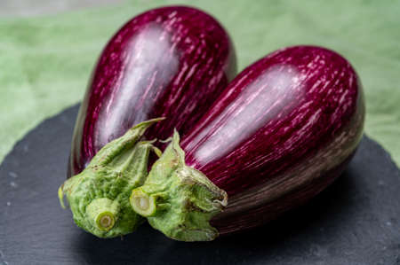 Fresh uncooked graffiti or Sicilian eggplants vegetables with purple and white stripes close up Imagens
