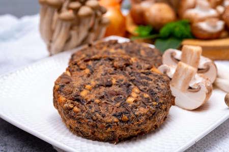 Tasty organic vegetarian food, burgers with champignons mushrooms, buna shimeji, carrot and onion