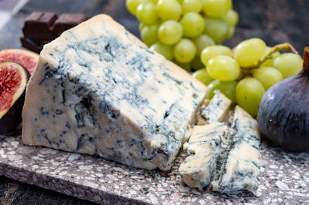 Cheese collection, piece of italian blue cheese gorgonzola picante with blue mold from north of Italy close up