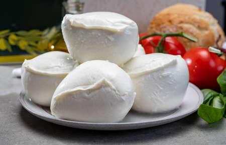 Fresh handmade soft Italian cheese from Campania, white balls of buffalo mozzarella cheese made from cow milk ready to eat close up Foto de archivo