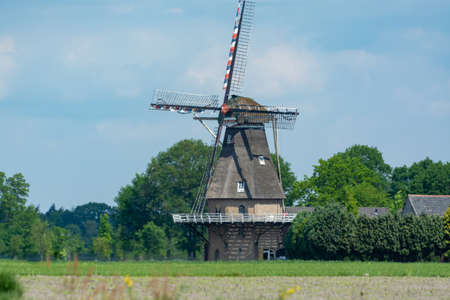 Countryside landscape with Dutch windmill, Oerle, Veldhoven, North Brabant, Netherlands in spring