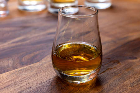 Scotch single malt or blended whisky tasting on distillery in Scotland, UK, close up Stock Photo