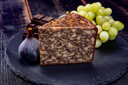 Cheese collection, Irish brown waxed marbeled cheddar cheese flavoured with  dark stout beer close up Imagens