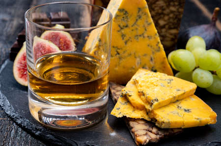 Tasting of Scotch single malt whisky and British cheeses close up